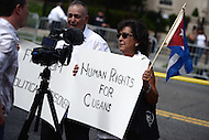 Washington, DC - July 20, 2015: A man and woman holds sign supporting human rights in Cuba after Cuban officials raised the flag at the re-opened Embassy of Cuba in the District of Columbia July 20, 2015. The embassy reopened after the United States began normalizing diplomatic relations with Cuba. (Photo by Don Baxter/Media Images International)
