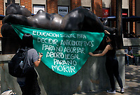 MEDELLIN, COLOMBIA - SEPTEMBER 28: Women try to cover a sculpture of Colombian artist Fernando Botero during a protest  in Medellin, Colombia on September 28, 2019. Several groups place green cloth banners on the faces of sculptures by artist Fernando Botero, protesting in the framework of the day of global action for access to legal and safe abortion, a symbolic action for women's rights. (Photo by VIEWPRESS/ Fredy Builes Corbis via Getty Images)