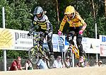 2018-07-08 / BMX / BK BMX Dessel / Karo Vertessen (l) en Bo Van Tiggel (r) vechten voor plaats twee en drie bij de vrouwen Elite achter Elke Vanhoof
