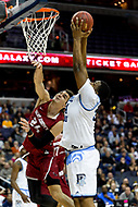 Washington, DC - MAR 10, 2018: Rhode Island Rams forward Andre Berry (34) goes up strong to the basket over Saint Joseph's Hawks forward Pierfrancesco Oliva (24) during the semi final match up of the Atlantic 10 men's basketball championship between Saint Joseph's and Rhode Island at the Capital One Arena in Washington, DC. (Photo by Phil Peters/Media Images International)