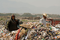 Impoverished Mexicans make a living by recycling metal and plastic from houshold waste on the Neza landfill site in Mexico City. Many of them are homeless live on the site with their children.