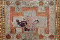 Fresco of Cupid surrounded by decorative patterns, painted c. 1552 by Niccolo dell'Abatte after drawings by Primaticcio, in the window recesses of the Ballroom or Galerie Henri II, Chateau de Fontainebleau, France. The Palace of Fontainebleau is one of the largest French royal palaces and was begun in the early 16th century for Francois I. It was listed as a UNESCO World Heritage Site in 1981. Picture by Manuel Cohen