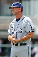 "5 June 2010:  FIU Head Coach Henry ""Turtle"" Thomas watches his players as they warm up prior to the game.  The Dartmouth Green Wave defeated the FIU Golden Panthers, 15-9, in Game 3 of the 2010 NCAA Coral Gables Regional at Alex Rodriguez Park in Coral Gables, Florida."