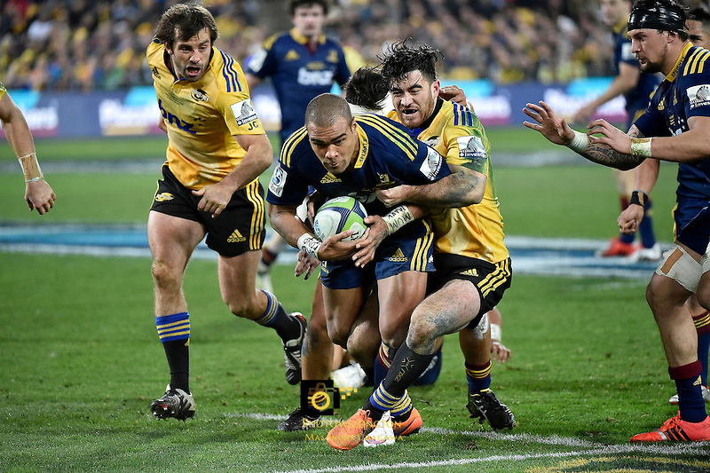 Highlanders' Patrick Osborne and Hurricanes' Nehe Milner-Skudder in action during the Super Rugby Final - Hurricanes v Highlanders at Westpac Stadium, Wellington, New Zealand on Saturday 4 July 2015.<br /> Photo by Masanori Udagawa. <br /> www.photowellington.photoshelter.com.