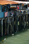 Thai fisherman homes on a pier at Samaesan in Chonburi, Thailand