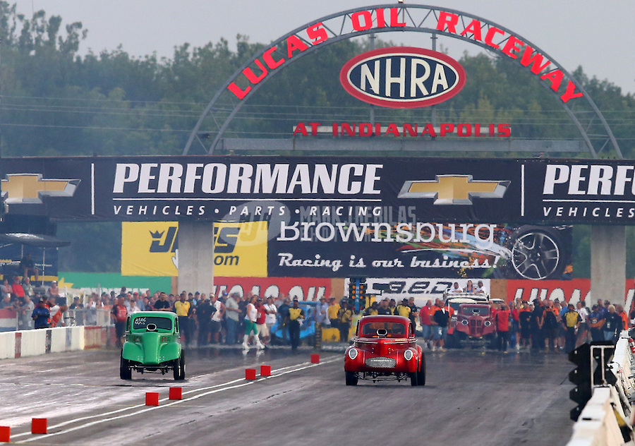 Sept. 1, 2013; Clermont, IN, USA: NHRA nostalgia gassers race during qualifying for the US Nationals at Lucas Oil Raceway. Mandatory Credit: Mark J. Rebilas-