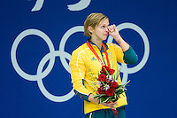15 AUG 2008 - BEIJING, CHN - Silver medallist Libby Trickett (AUS) wipes her eyes at the medal ceremony for the Women's 100m Freestyle final -  Beijing Olympics. (PHOTO (C) NIGEL FARROW) *** IOC RULES APPLY ON USAGE ***