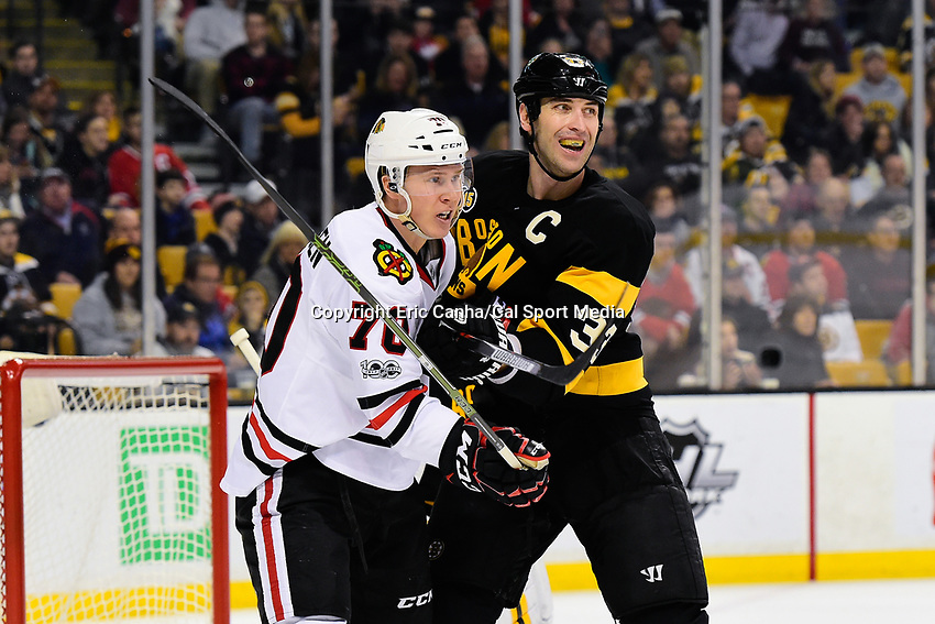 Friday, January 20, 2017: Boston Bruins defenseman Zdeno Chara (33) battles Chicago Blackhawks center Dennis Rasmussen (70) in front of the net during the National Hockey League game between the Chicago Blackhawks and the Boston Bruins held at TD Garden, in Boston, Mass. Chicago defeats Boston 1-0 in regulation time. Eric Canha/CSM