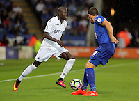 Pictured (L-R): Modou Barrow of Swansea City against Christian Fuchs of Leicester City Saturday 27 August 2016<br /> Re: Swansea City FC v Leicester City FC Premier League game at the King Power Stadium, Leicester, England, UK