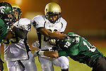 Torrance, CA 10/06/11 - James Nelson (Peninsula #26) and Drew Lawrence (South Torrance #12) in action during the Peninsula vs South Varsity football game.