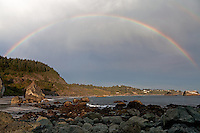 Rainbow arcs over the shoreline at Brookings, Oregon.