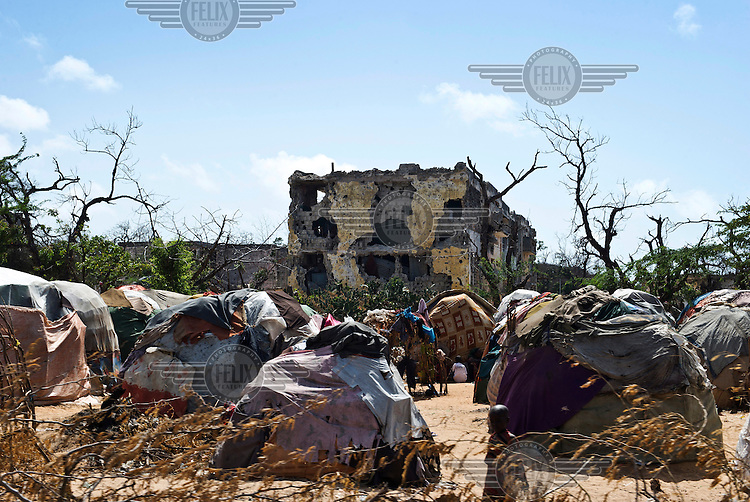Tents and destroyed buildings at an IDP (internally displaced persons) camp in Mogadishu. The people staying here fled famine in South Somalia.