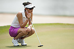 CHON BURI, THAILAND - FEBRUARY 16:  Michelle Wie of USA lines up a putt on the 8th hole during day one of the LPGA Thailand at Siam Country Club on February 16, 2012 in Chon Buri, Thailand.  Photo by Victor Fraile / The Power of Sport Images