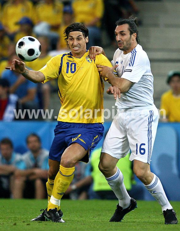**ALL ROUND PICTURES FROM SOLARPIX.COM**.**SYNDICATION RIGHTS FOR UK AND SPAIN ONLY**.European Championship tournament Euro 2008, Greece versus Sweden at the Wals-Siezenheim Stadium, Salzburg, Austria. Sweden 2 Greece 0. 10th June 2008..This pic: Zlatan Ibrahimovic and Sotirios Kyrgiakos..JOB REF: 6606 CPR/Ronny Hartmann       .DATE: 10_06_2008.**MUST CREDIT SOLARPIX.COM OR DOUBLE FEE WILL BE CHARGED* *UNDER NO CIRCUMSTANCES IS THIS IMAGE TO BE REPRODUCED FOR ANY ONLINE EDITION WITHOUT PRIOR PERMISSION*