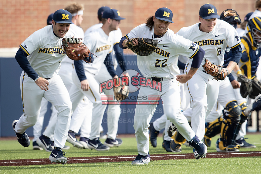 Michigan Wolverines first baseman Jordan Brewer (22) runs onto the field against the Western Michigan Broncos on March 18, 2019 in the NCAA baseball game at Ray Fisher Stadium in Ann Arbor, Michigan. Michigan defeated Western Michigan 12-5. (Andrew Woolley/Four Seam Images)