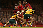 Australian flanker Michael Hooper tackles Wales wing Alex Cuthbert.<br /> Dove Men Series 2014<br /> Wales v Australia<br /> Millennium Stadium<br /> 08.11.14<br /> ©Steve Pope-SPORTINGWALES