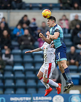 Luke O'Nien of Wycombe Wanderers & Jimmy Smith of Crawley Town during the Sky Bet League 2 match between Wycombe Wanderers and Crawley Town at Adams Park, High Wycombe, England on 25 February 2017. Photo by Andy Rowland / PRiME Media Images.
