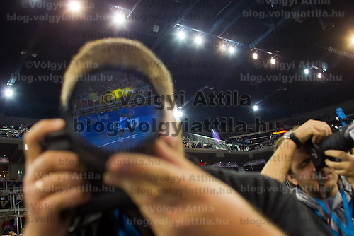 Player is reflected on the lens of a photographer during the Tennis Classics senior tournament in Budapest, Hungary on October 29, 2011. ATTILA VOLGYI