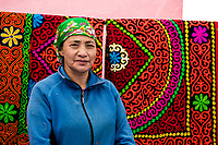 Mongolia, Bayan-Ulgii, Ulgii, Altai Mountains. Women vendors in local market.