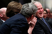 Former President George W. Bush smiles with his brother Jeb Bush at the State Funeral for their father, former President George H.W. Bush, at the National Cathedral, Wednesday, Dec. 5, 2018, in Washington.<br /> Credit: Alex Brandon / Pool via CNP