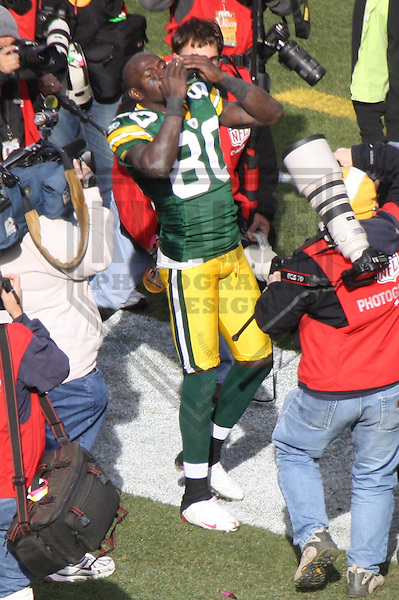 GREEN BAY - SEPTEMBER 2009:  Donald Driver (80) of the Green Bay Packers waives to the crowd following a game on October 18, 2009 at Lambeau Field in Green Bay, Wisconsin. (Photo by Brad Krause)