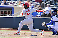 Jermaine Curtis #23 of the Memphis Redbirds swings against the Omaha Storm Chasers at Werner Park on April 9, 2014 in Omaha, Nebraska. The Storm Chasers beat the Redbirds 20-3.   (Dennis Hubbard/Four Seam Images)