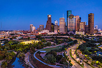 Houston Skyline Along Allen Parkway -  Houston Skyline at twilight or blue hour from Allen Parkway which runs along Buffalo Bayou in downtown. This area of the city is the theater district which includes muserums, theater art, opera, and other music events. The Houston cityscape includes many of the tallest building in Texas and the southern US.
