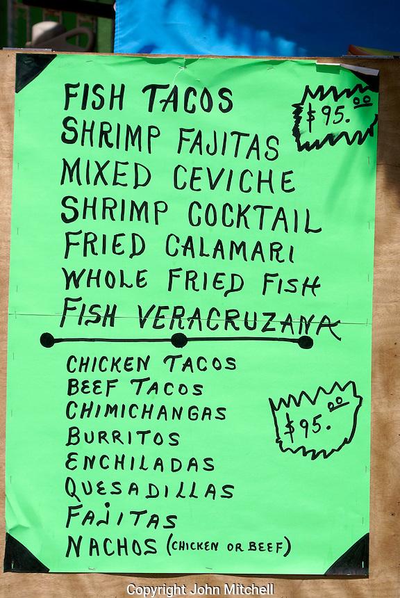 Menu outside a seafood restaurant  in Playa del Carmen, Riviera Maya, Quintana Roo, Mexico.
