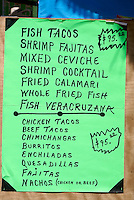 Menu outside a seafood restaurant  in Playa del Carmen, Riviera Maya, Quintana Roo, Mexico.