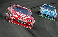 Oct. 11, 2009; Fontana, CA, USA; NASCAR Sprint Cup Series driver Juan Pablo Montoya leads Jimmie Johnson during the Pepsi 500 at Auto Club Speedway. Mandatory Credit: Mark J. Rebilas-