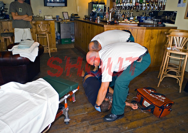 West Country Ambulance Paramedics attending to an unconscious casualty in a pub. This image may only be used to portray the subject in a positive manner..©shoutpictures.com..john@shoutpictures.com