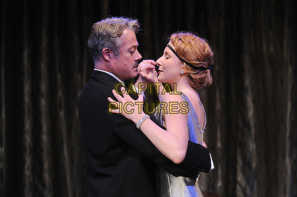 LONDON, ENGLAND - JULY 15: Robert Portal and Dorothea Myer-Bennett appear in a new theatre production of This Was A Man, directed by Belinda Lang - a previously unseen play by Noel Coward about a successful painter who becomes aware of his wife's infidelity, Finborough Theatre on July 15, 2014 in London, England<br /> CAP/BEL<br /> &copy;Tom Belcher/Capital Pictures