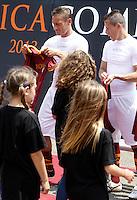 Il capitano della Roma Francesco Totti ed il centrocampista brasiliano Rodrigo Taddei, a destra, alla presentazione delle nuove maglie, al centro sportivo di Trigoria, Roma, 11 luglio 2013.<br /> AS Roma football team's captain Francesco Totti and midfielder Rodrigo Taddei, of Brazil, right, attend the presentation of the new jerseys at the club's sporting centre on the outskirts of Rome, 11 July 2013.<br /> UPDATE IMAGES PRESS/Isabella Bonotto