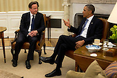 United States President Barack Obama, right, speaks with Prime Minister David Cameron of Great Britain in the Oval Office of the White House in Washington, D.C., U.S., on Monday, May 13, 2013. Cameron rebuked lawmakers in his Conservative Party who have already decided that Britain should withdraw from the European Union. .Credit: Andrew Harrer / Pool via CNP