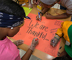 Student volunteers share what they are thankful for during a Thanksgiving meal served to Sunnyside residents at Worthing High School, November 23, 2013.