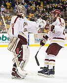 Parker Milner (BC - 35) and Bill Arnold (BC - 24) celebrate Gaudreau's goal. - The Boston College Eagles defeated the Providence College Friars 4-2 in their Hockey East semi-final on Friday, March 16, 2012, at TD Garden in Boston, Massachusetts.