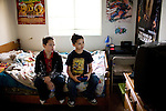Isaiah and Daniel Sawyer play video games on the bed they share January 27, 2010 in Sacramento, Calif. The Sawyer family receives $540/month in CalWORKs assistance from the state of California. Dennis is currently unable to work while recovering from cancer, and Sophia hasn't been able to find work. Gov. Arnold Schwarzenegger has proposed eliminating the CalWORKs program in an effort to balance the state's budget. CREDIT: Max Whittaker for The Wall Street Journal.CABUDGET