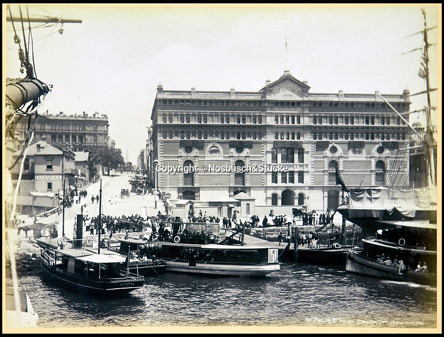 BNPS.co.uk (01202 558833)<br /> Pic: Nosbüsch&Stucke/BNPS<br /> <br /> Phillips Street, Sydney Circular Quay.<br /> <br /> A stunning collection of photographs of Sydney decades before the iconic harbour bridge and opera house were built has been unearthed after 129 years.<br /> <br /> The black and white photo album captures the bustling city centre, picturesque main harbour and famous beaches of the future tourist hot-spot. <br /> <br /> The photos were taken by celebrated Australian photographer Henry King in 1888 who was born in England but emigrated to Australia at a young age and spent the rest of his life there.<br /> <br /> More recently they have fallen into the hands of a German collector who has decided to put them on the market and they are tipped to sell for £1,800.<br /> <br /> Many of Sydney's most recognisable landmarks including Manly beach and Coogee bay look very different to what backpackers would encounter today.<br /> <br /> King also took various photos of Circular Quay - the city's main harbour - but missing from them are images of the Sydney Harbour Bridge and Sydney Opera House as these landmarks were both not built until well into the 20th century.