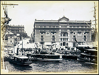 BNPS.co.uk (01202 558833)<br /> Pic: Nosb&uuml;sch&amp;Stucke/BNPS<br /> <br /> Phillips Street, Sydney Circular Quay.<br /> <br /> A stunning collection of photographs of Sydney decades before the iconic harbour bridge and opera house were built has been unearthed after 129 years.<br /> <br /> The black and white photo album captures the bustling city centre, picturesque main harbour and famous beaches of the future tourist hot-spot. <br /> <br /> The photos were taken by celebrated Australian photographer Henry King in 1888 who was born in England but emigrated to Australia at a young age and spent the rest of his life there.<br /> <br /> More recently they have fallen into the hands of a German collector who has decided to put them on the market and they are tipped to sell for &pound;1,800.<br /> <br /> Many of Sydney's most recognisable landmarks including Manly beach and Coogee bay look very different to what backpackers would encounter today.<br /> <br /> King also took various photos of Circular Quay - the city's main harbour - but missing from them are images of the Sydney Harbour Bridge and Sydney Opera House as these landmarks were both not built until well into the 20th century.