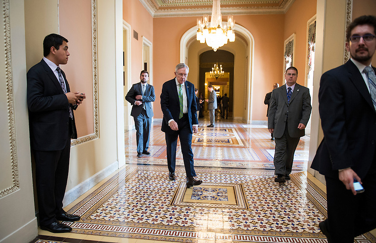 UNITED STATES - JUNE 24: Senate Majority Leader Harry Reid, D-Nev., walks to the Ohio Clock Corridor to speak to the media following the Senate Democrats' policy lunch on Tuesday, June 24, 2014. (Photo By Bill Clark/CQ Roll Call)