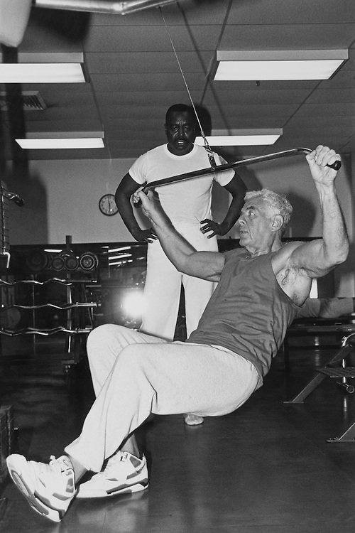 "A few members went for workouts, Thursday afternoon including Speaker of the House Rep. Thomas Stephen ""Tom"" Foley, D-Wash who with  Joe Poineu, head of his security, in the Piney Point workout room. January 30, 1992 (Photo by Maureen Keating/CQ Roll Call)"