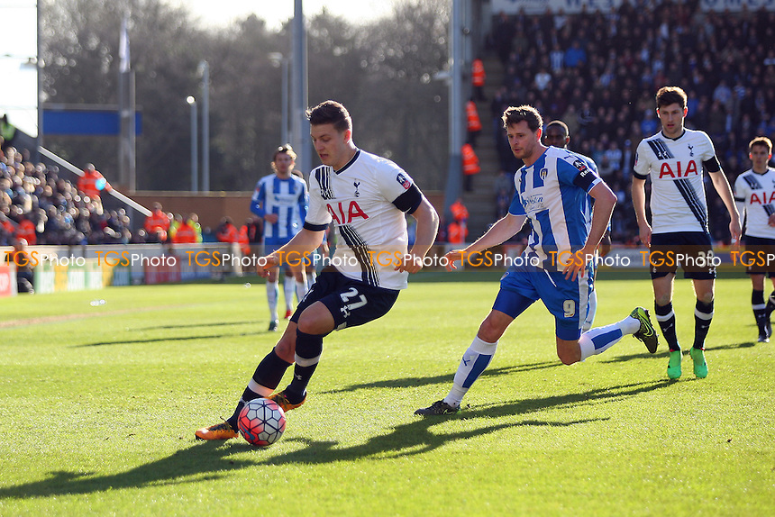 Kevin Wimmer of Tottenham Hotspur chased by Chris Porter of Colchester United during Colchester United vs Tottenham Hotspur, Emirates FA Cup Football at the Weston Homes Community Stadium