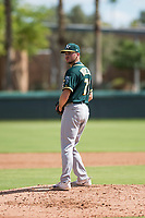 Oakland Athletics relief pitcher Brandon Withers (71) gets ready to deliver a pitch during an Instructional League game against the Los Angeles Dodgers at Camelback Ranch on October 4, 2018 in Glendale, Arizona. (Zachary Lucy/Four Seam Images)