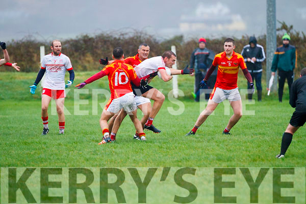 Valentia's Paul O'Connor & Ger O'Shea holding up Waterville's Cormac O'Sullivan in the South Kerry Senior Championship Quarter Final in Waterville on Saturday.
