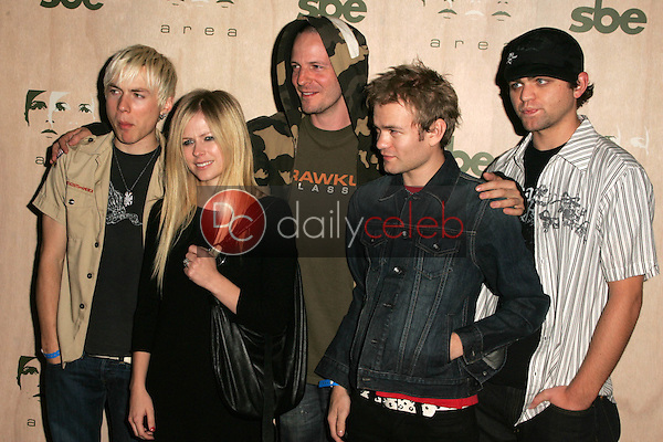Deryck Whibley with Avril Lavigne and her band<br />
