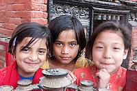 Nepal, Kathmandu.  Hindu Girls at Entrance to Neighborhood Shrine.