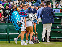 London, England, 4 th. July, 2018, Tennis,  Wimbledon, Woman's doubles: Elise Mertens (BEL) and Demi Schuurs (NED) (L) leaving the court for a rain delay<br /> Photo: Henk Koster/tennisimages.com