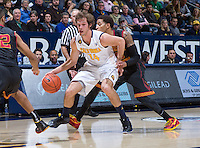 California's Ricky Kreklow working his way around USC defenders during a game at Haas Pavilion in Berkeley, California on February 23th, 2014. California defeated USC 77 - 64