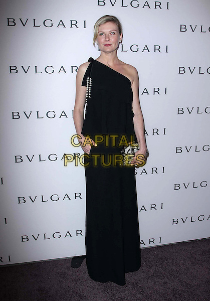 Kirsten Dunst.BVLGARI celebrates Elizabeth Taylor's magnificent collection of BVLGARI jewelry held at the BVLGARI store, Beverly Hills, California, USA..February 19th, 2013.full length silver gold clutch bag diamonds embellished jewel encrusted black dress one shoulder  hand in pocket .CAP/ADM/FS.©Faye Sadou/AdMedia/Capital Pictures.