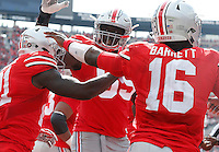 Ohio State Buckeyes quarterback J.T. Barrett (16) Ohio State Buckeyes offensive lineman Isaiah Prince (59) congratulate Ohio State Buckeyes wide receiver Parris Campbell (21) on his touchdown in the third quarter of their game at Ohio Stadium in Columbus, Ohio on October 1, 2016. (Columbus Dispatch photo by Brooke LaValley)